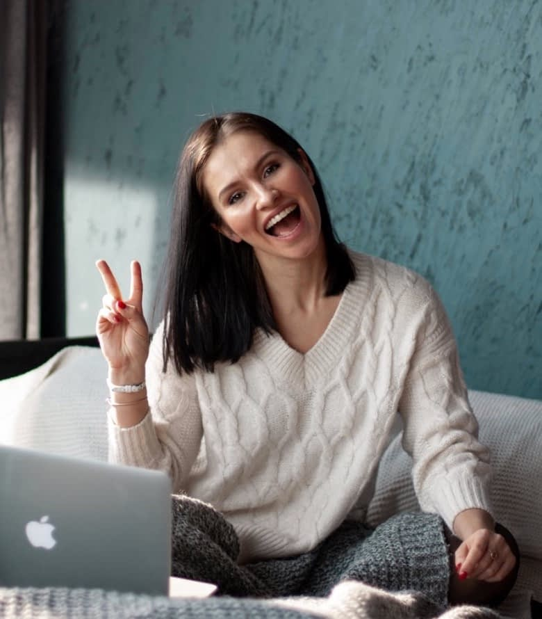 Woman smiling and happy while working on Online Advertising